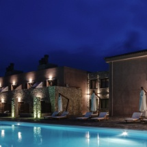 illuminated romantic swimming pool of perivoli country hotel and retreat in nafplio under magnificent starry night sky