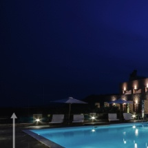 empty and illuminated outdoor swimming pool of greek luxury hotel in pyrgiotika nafplio during summer vacation