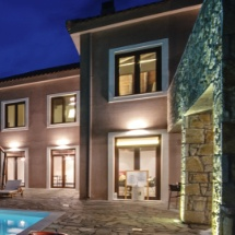 beautifully lit architecture of luxury and country hotel perivoli in nafplio with restaurant next to the swimming pool